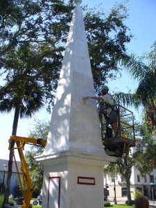 Antwa lime washing the monument